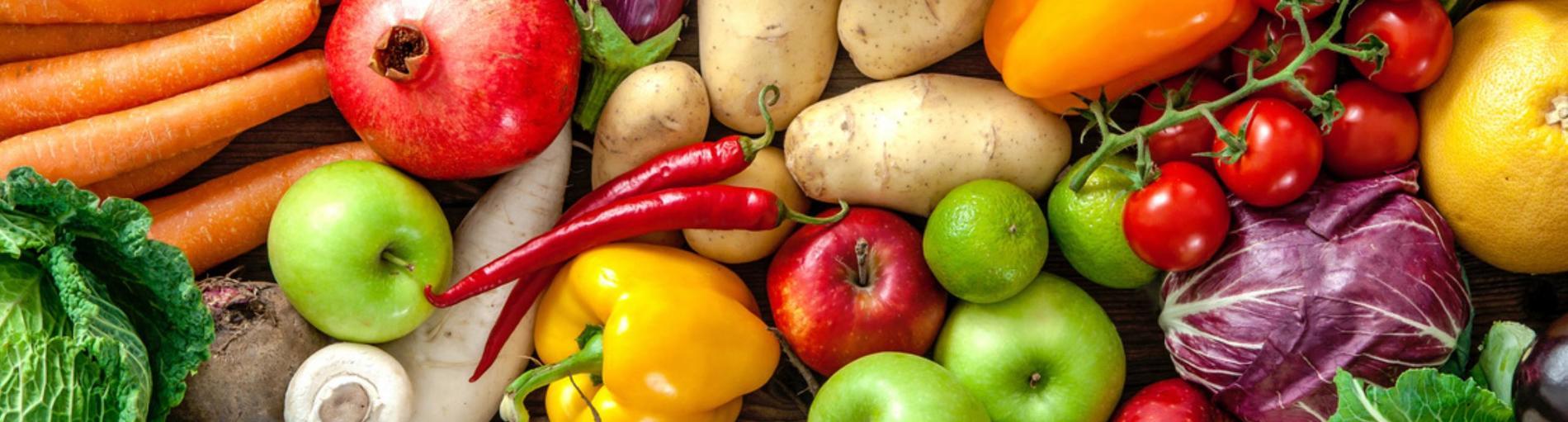 Bild mit vielen verschiedenen Gemüsesorten und der Aufschrift vegetarisch und vegan essen.