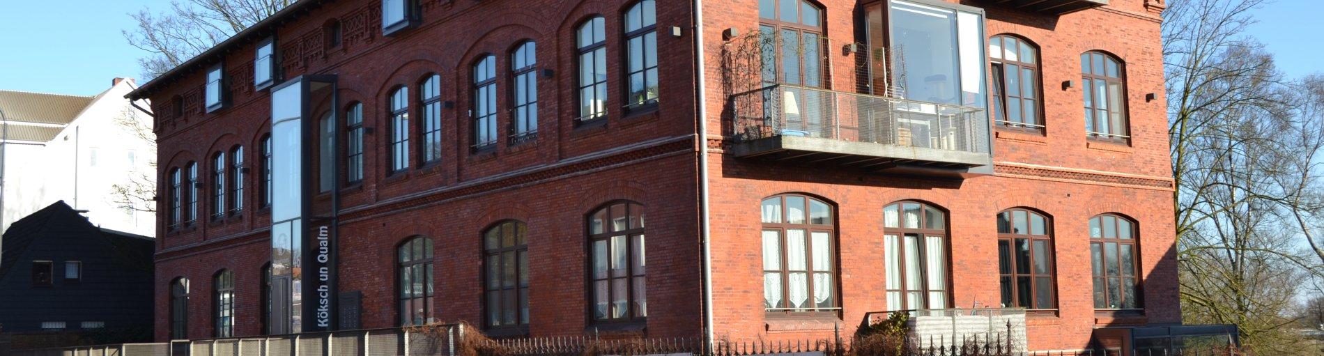 Eine Außenaufnahme des Backsteingebäudes von Köksch un Qualm