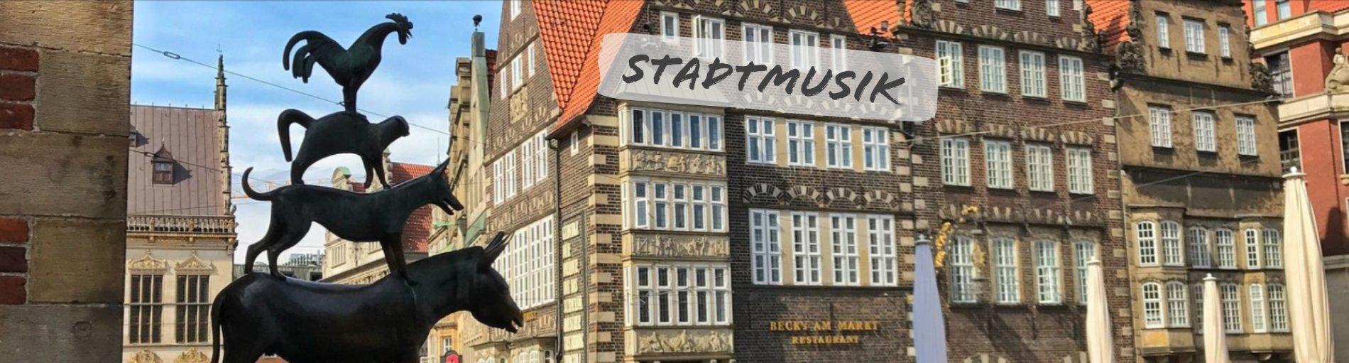 Die Bremer Stadtmusikanten mit dem Schriftzug Stadtmusik