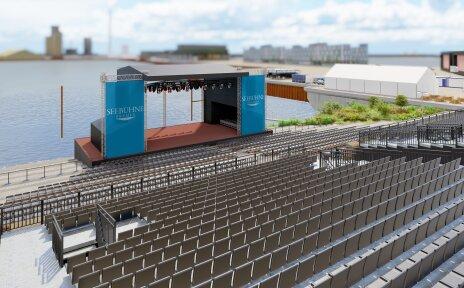 Zu sehen ist ein Entwurf, wie die Seebühne aussehen könnte. Davor befinden sich einige Sitzreihen für die Zuschauer. Die Seebühne wurde mit einem blauen Anstrich versehen.