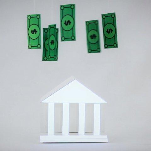 Geldscheine über einem Gebäude