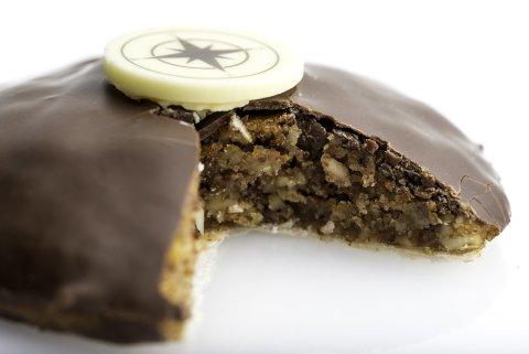 Ein angebissenes Stück Lebkuchen mit Schokolade überzogen